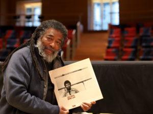 Wadada Leo Smith holding the 1978 Divine Love LP